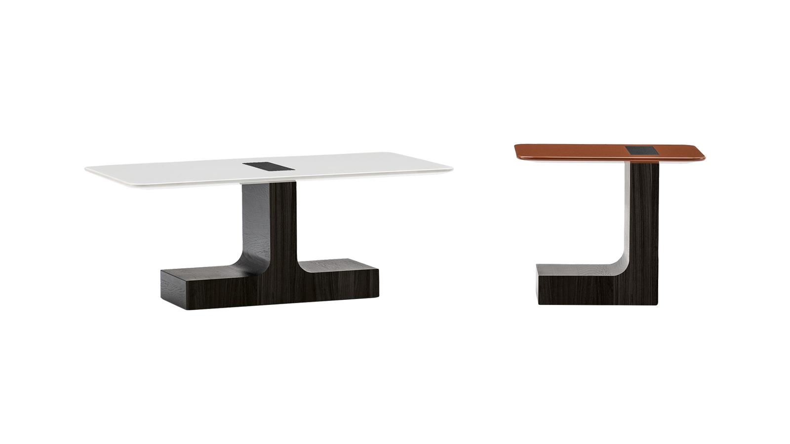A Minotti Block asztala a kontrasztok szép játéka: robosztus, masszív, tömör fa lábazatát, mely L vagy T betűt formáz, a brutalista építészet ihlette, míg asztallapja leheletvékony, szinte észrevehetetlenül lebeg a térben. Rodolfo Dordoni alkotása egyértelműen szoborszerű, azonnal észreveteti magát, akárhová helyezzük – még akkor is, ha a két elérhető méret közül az alacsonyabbat választjuk. Lekerekített éleinek köszönhetően egyébként a Block a nehezen kihasználható sarkokban vagy szűk előterekben is jó szolgálatot tehet,mint sokoldalú lerakóasztal.