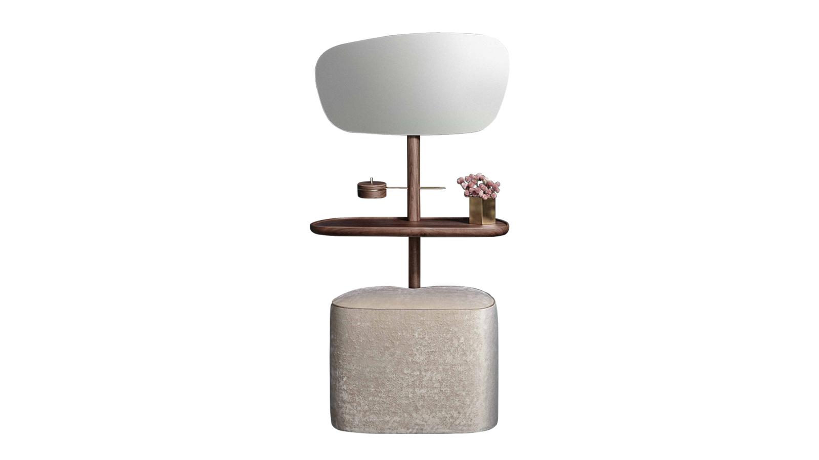 A Nomon fésülködőasztalt az érzéki, modern nő ihlette, aki funkcionalitásra és szépségre vágyik otthonában. A bútor lágy felületei, lekerekített élei egyaránt megjelennek a fa szerkezeten és a tükrön, valamint a kombinációhoz szervesen hozzátartozó, kárpitozott ülőkén is.